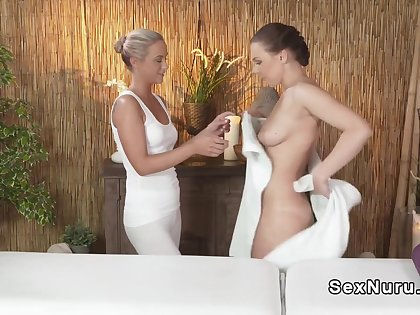 Blonde masseuse satisfied and rubbing brunette