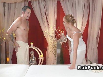 Festival masseuse giving massage on fat dick