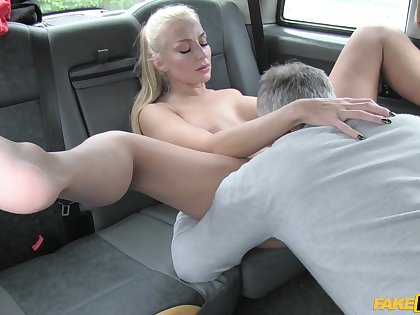 Tattooed blonde pornstar Kayla Unfledged fucked in the back be advisable for the cab