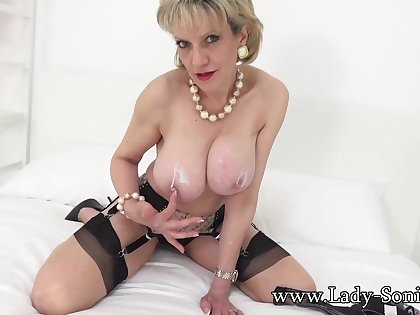 Lady Sonia lotions up her big chesty tits