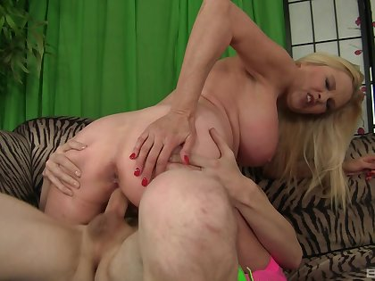 Rough pussy action for the busty mom after she sits on top