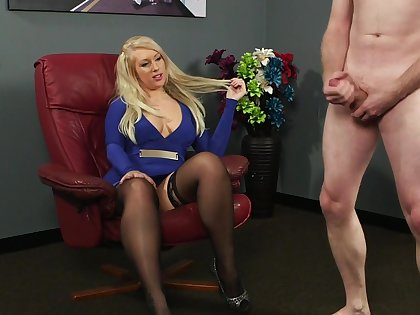 Clothed blonde is surprises to feel such dick in her fingertips