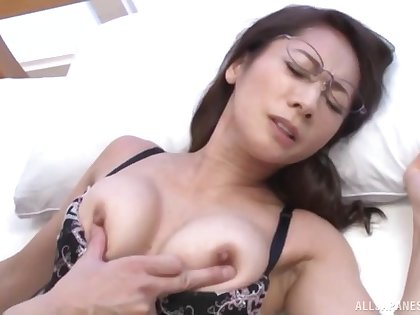 Passionate fucking on the bed with a sexy Japanese housewife