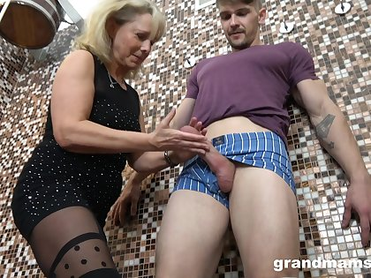 Lust crazed old woman is take than eager to suck a young man's fresh cock