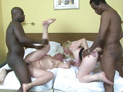 Two full-grown sluts Monika and Meri enjoy having interracial anal sex