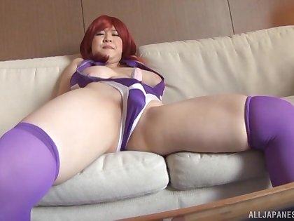 Solo Japanese redhead Yatsuka Mikoto enjoys masturbating close to a toy