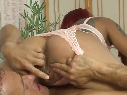 Asian redhead masseuse rides on a cock be fitting of the happy ending